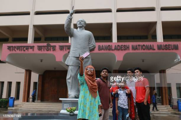 Visitors take group selfie in front of Bangladesh Natuonal Museum after reopen following the Covid-19 pandemic in Dhaka, Bangladesh on November 1,...