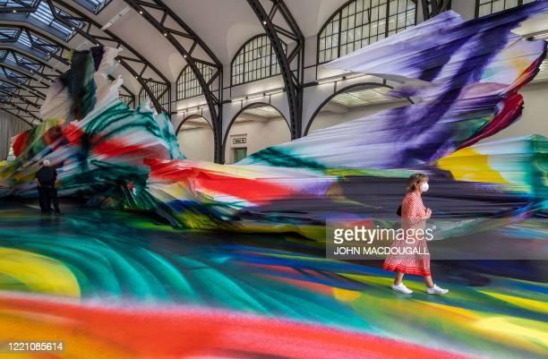 "Visitors take in German artist Katharina Grosse's installation ""It Wasn't Us"" at Berlin's Hamburger Bahnhof museum for contemporary art on June 19,..."