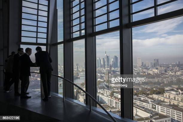 Visitors take in the city skyline view from the 15th floor pantry area inside the European Central Bank headquarters as skyscrapers tower over...
