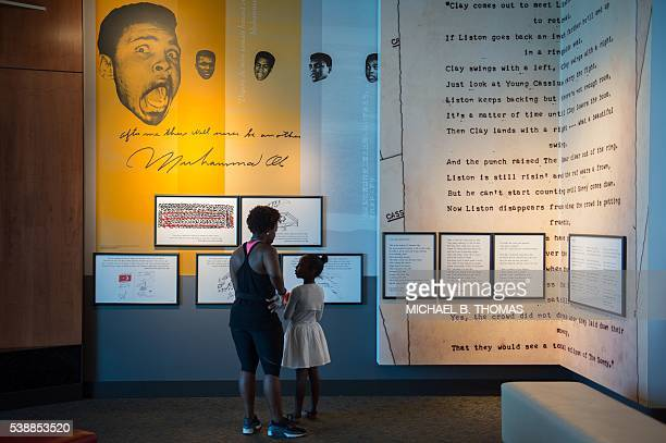 Visitors take in the exhibits at Muhammad Ali Center on June 8 2016 in Louisville Kentucky All of the roughly 15000 tickets for the June 10th public...