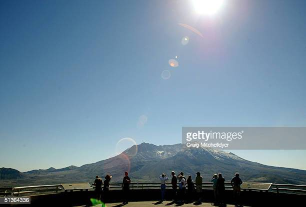 Visitors take in the view of Mt St Helens from the Johnston Ridge Observatory September 27 2004 Hundreds of tiny earthquakes have registered on...