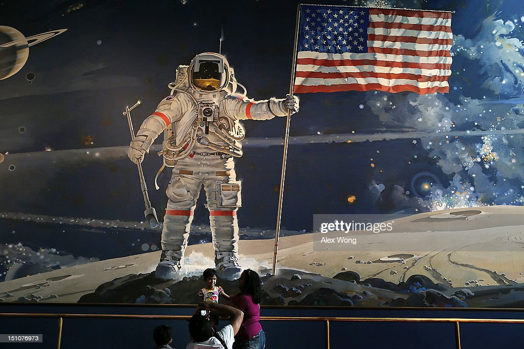 People Look At Apollo 11 Exhibit The Day Of Neil Armstrong Funeral : News Photo