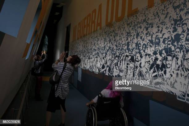 Visitors take photographs with mobile devices at the Museo Casa de la Memoria in Medellin Colombia on Tuesday Oct 3 2017 In Colombia where more than...