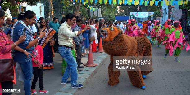 Visitors take photos on mobile of Chhau Dance a mythological act in Kolkata Artist from Purulia performing Chhau Dance a mythological act during a...