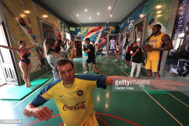 Visitors take photos with Lebron James wax figure at the Museo de Cera on August 11 2020 in Mexico City Mexico Despite Mexico City government allowed...