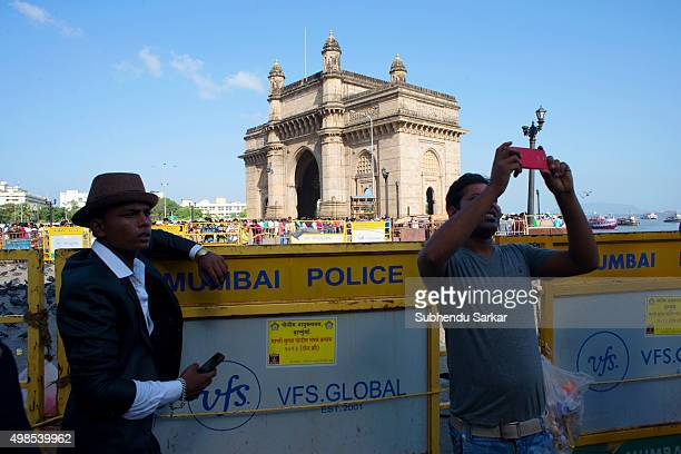 Visitors take photos with mobile phone near Gateway of India in south Mumbai Built to commemorate the visit of King George V and Queen Mary to Mumbai...