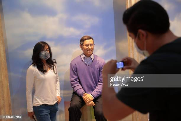 Visitors take photos with the wax figure of Bill Gates on August 11, 2020 in Mexico City, Mexico. Despite Mexico City government allowed museums to...