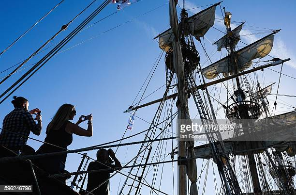 Visitors take pictures during a visit to one of the ships moored at the quayside during the North Sea Tall Ships Regatta on August 27 2016 in Blyth...