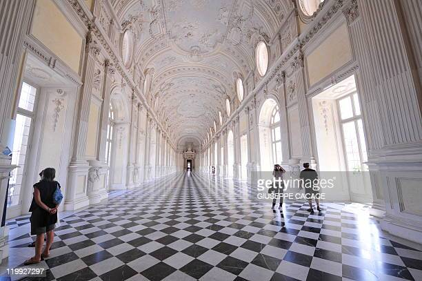 Visitors take pictures in the Great Gallery of the Venaria Reale palaceon July 23 2011 in Venaria Reale near Turin The palace conceived by 16th and...