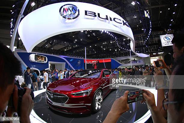 Visitors take pictures of a Buick Avista at Beijing International Automotive Exhibition on April 27 2016 in Beijing China