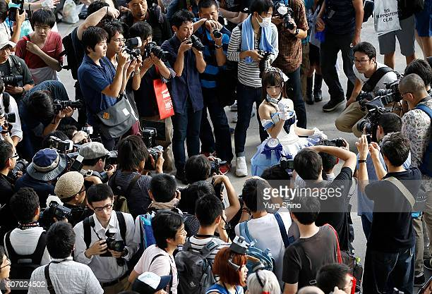 Visitors take pictures of a cosplayer at Tokyo Game Show on September 17 2016 in Chiba Japan Tokyo Game Show 2016 is held from September 15 to...