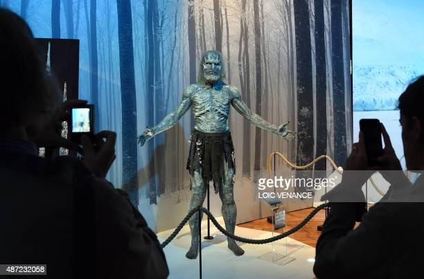 Visitors take pictures of a model of a White Walker character on September 7 2015 during the opening of an exhibition dedicated to HBO's television...