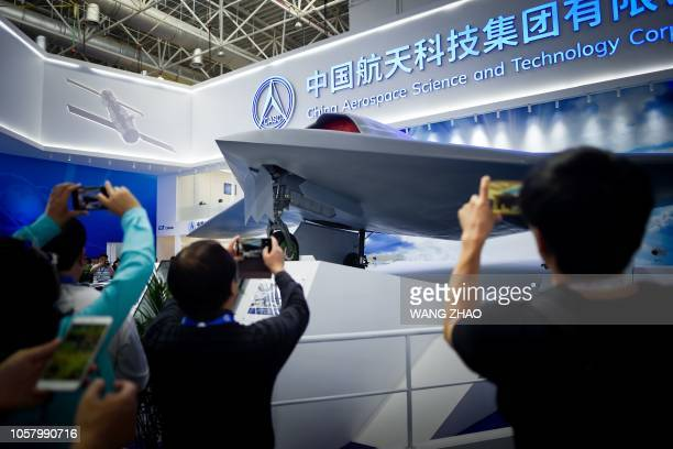 Visitors take pictures of a model of CH7 HALE Stealth Unmanned Reconnaissance Aircraft at the Airshow China 2018 in Zhuhai south China's Guangdong...