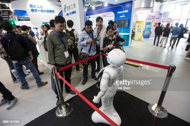 Visitors take pictures of a robot while attending the 2015 Computing Conference in Hangzhou China on Wednesday Oct 14 2015 Alibaba Group Holding...