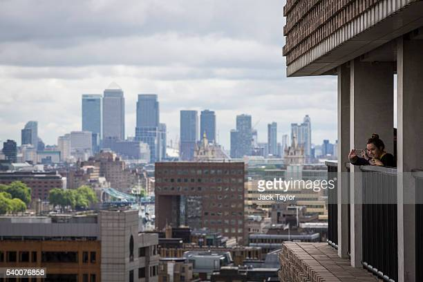 Visitors take pictures of the London skyline from the 10th floor viewing platform at the Tate Modern's new Switch House on June 14 2016 in London...