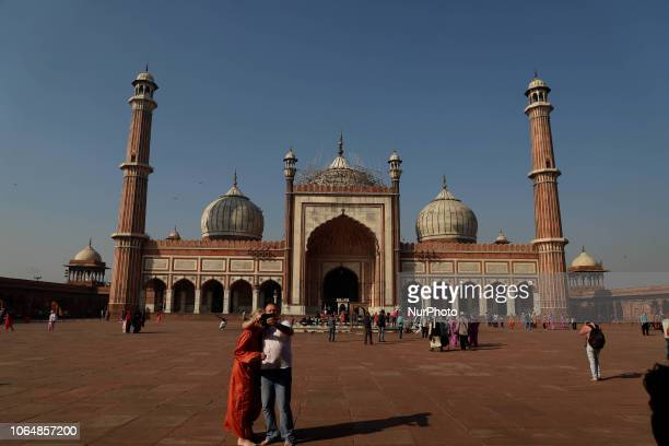Visitors take selfie with Jama Masjid in the background in Delhi India on 24 November 2018