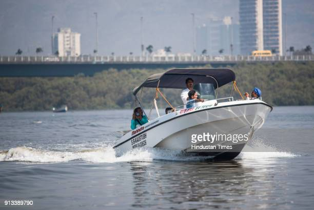 Visitors take the first boat ride of Flamingo Sanctuary inside Thane Creek on February 1 2018 in Mumbai India
