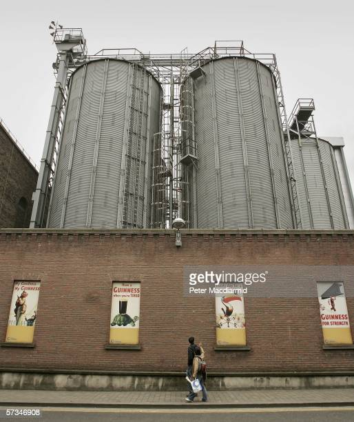 Visitors take walk past the Guinness brewery on April 16 2006 in Dublin Ireland