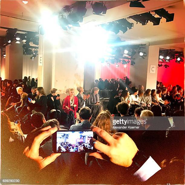 A visitors takes photos with his smartphone at the DEPRESSION Show during the MercedesBenz Fashion Week Berlin A/W 2017 at Kaufhaus Jandorf on...