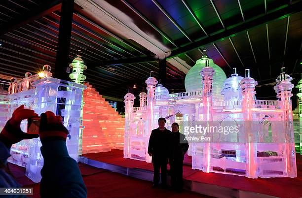 """Visitors taking photos at """"Fantasy Ice World"""" on January 23, 2014 in Taipei, Taiwan. Ice sculptors from the famous Harbin Ice Festival create the 7..."""