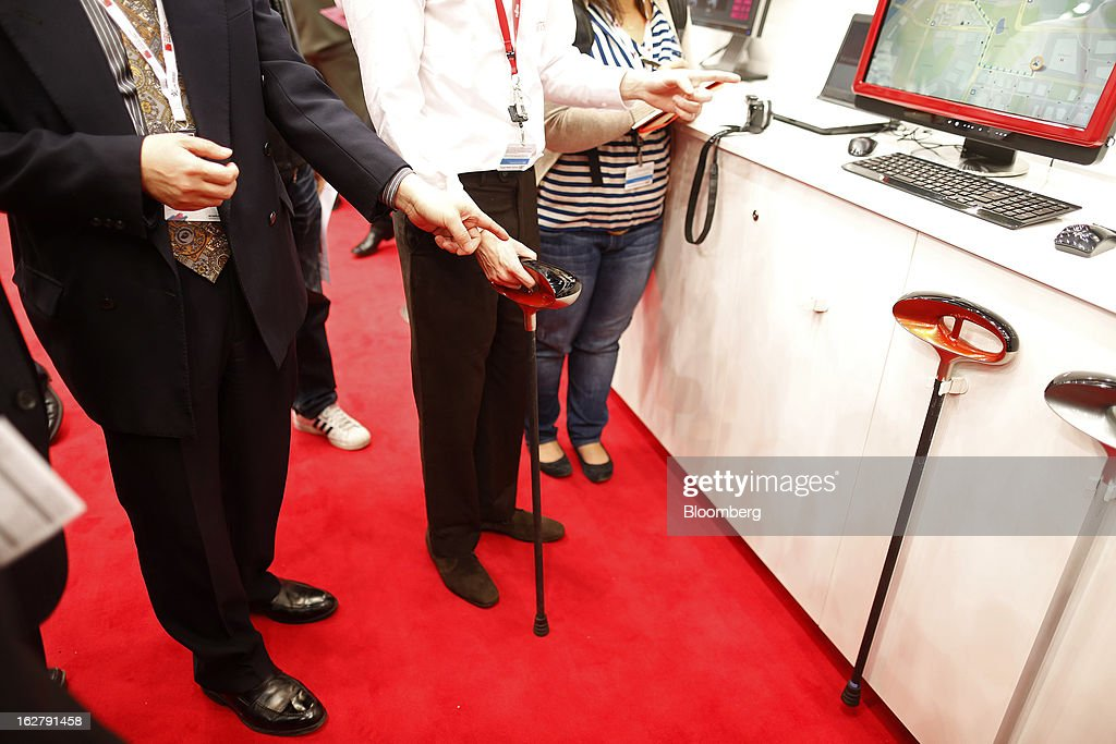 Visitors test new generation Human-centric Intelligent Society (HCIS) digital walking canes in the Fujitsu Ltd. pavilion at the Mobile World Congress in Barcelona, Spain, on Wednesday, Feb. 27, 2013. The Mobile World Congress, where 1,500 exhibitors converge to discuss the future of wireless communication, is a global showcase for the mobile technology industry and runs from Feb. 25 through Feb. 28. Photographer: Simon Dawson/Bloomberg via Getty Images