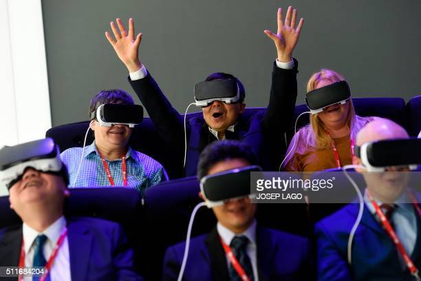 Visitors test the new 'Oculus VR' virtual device at the Samsung stand during the Mobile World Congress in Barcelona on February 22 on the first day...