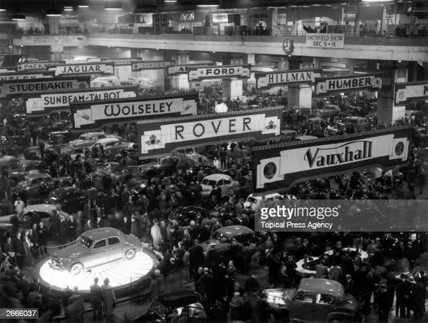 Visitors throng the 34th International Motor Exhibition held at Earls Court London