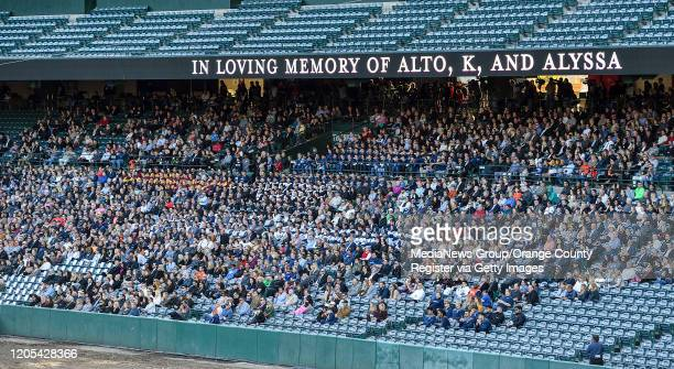 Visitors to a memorial service for the Altobelli family sit on the third base side of Angel Stadium in Anaheim CA on Monday Feb 10 2020 Orange Coast...