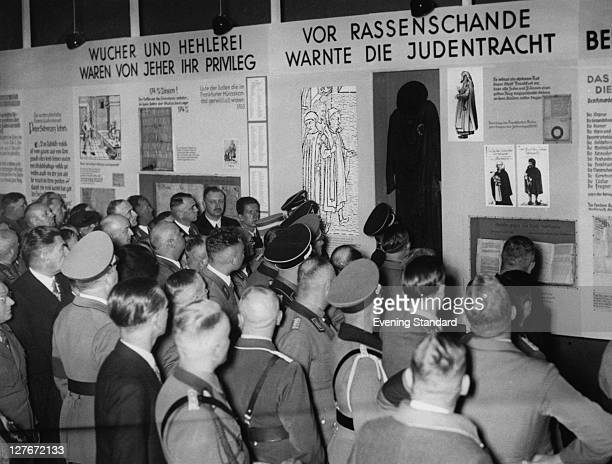 Visitors to an antisemitic exhibition organized by the Nazi party entitled 'The Eternal Jew' in the Library of the German Museum in Munich November...
