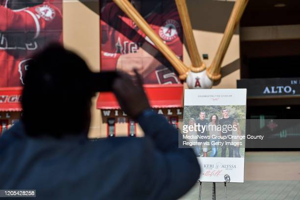 A visitors to Angel Stadium takes a picture outside a memorial service for the Altobelli family in Anaheim CA on Monday Feb 10 2020 Orange Coast...