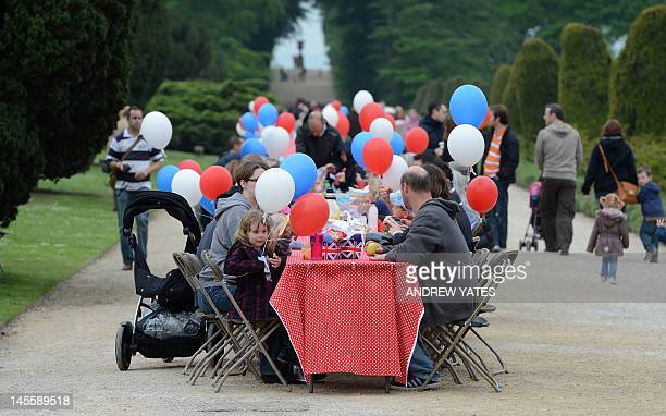 Visitors to Chatsworth Park in Derbyshire central England enjoy their picnics on street party themed tables to celebrate the Queen's Jubilee on June...