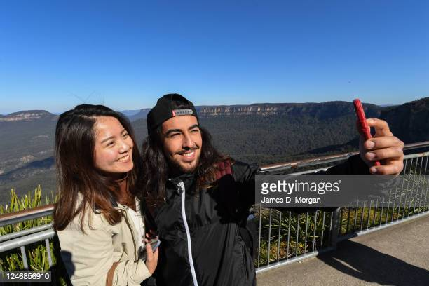 Visitors to Echo Point in the Blue Mountains take a selfie on June 06, 2020 in Katoomba, Australia. Restrictions continue to ease around Australia in...