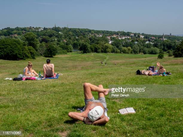 Visitors to Hampstead Heath enjoy the sunshine at Parliament Hill Viewpoint on June 29 2019 in London England