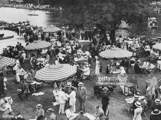 Visitors to London's new riverside resort the 'Karsino' on Tagg's Island in the River Thames taking afternoon tea 22nd June 1913 The Karsino was...