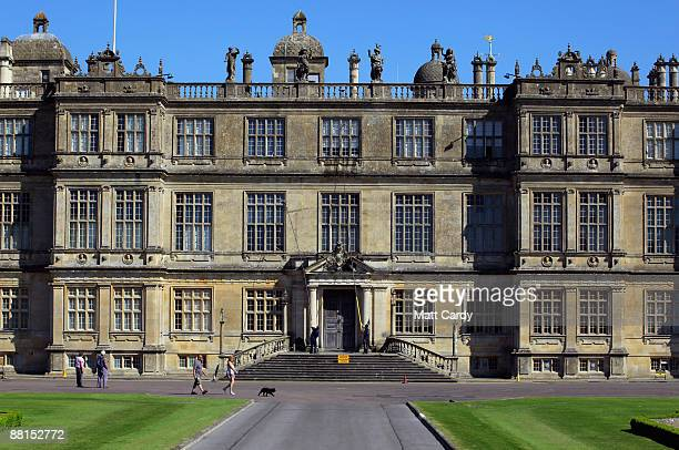 Visitors to Longleat pass as professional window cleaners Nick Walker and Daniel Barr clean one of the windows at the front of Longleat House ahead...