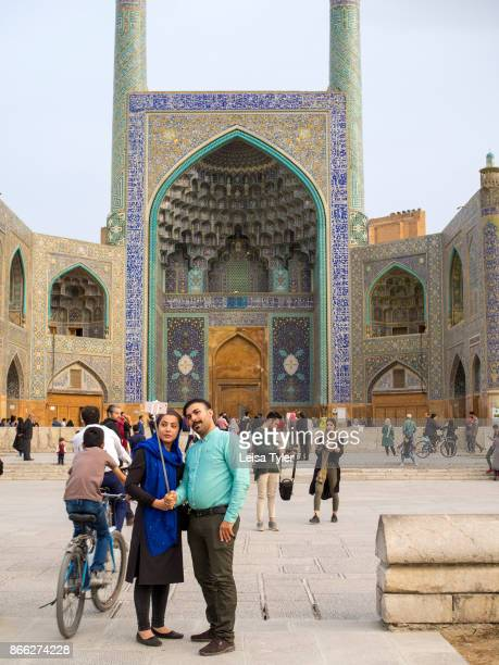 Visitors to Maydane Imam Square also known as Naqshe Jahan Square in Esfahan Iran It is a UNESCO World Heritage Site
