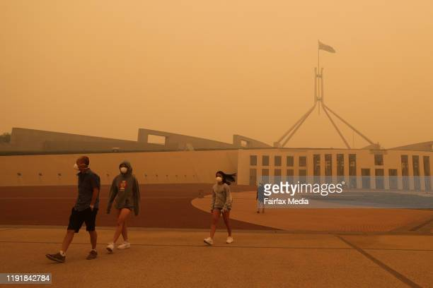 Visitors to Parliament House are forced to wear face masks after smoke from bushfires blankets Canberra in a haze with hazardous air quality on...