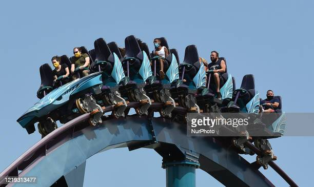 Visitors to SeaWorld Orlando are seen wearing face masks and social distancing on one of the theme park's roller coasters as the attraction reopens...