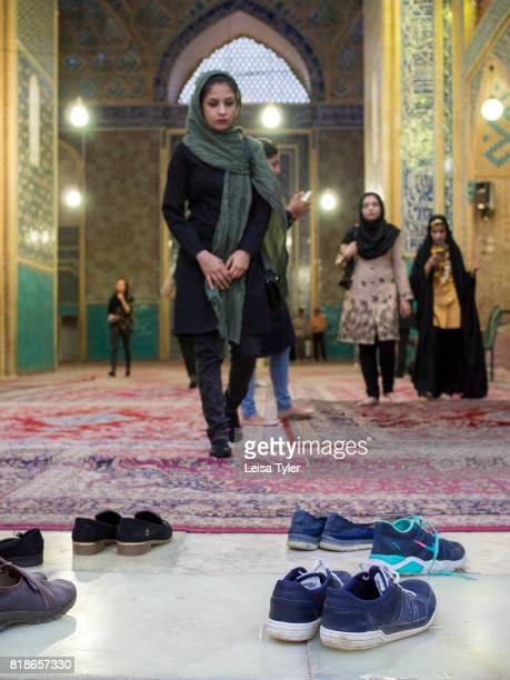 Visitors to the 14th century Masjide Jame Mosque in Yazd Iran The mosque is renowned for its mosaic tiles and having the tallest portal in the country