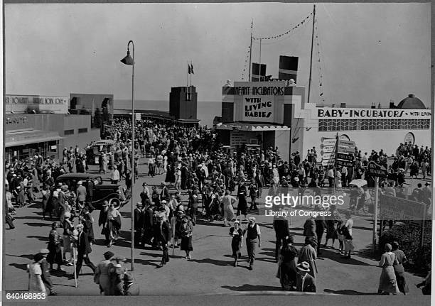Visitors to the 1933 World's Fair flock to the Infant Incubators Building to see live babies Chicago Illinois USA
