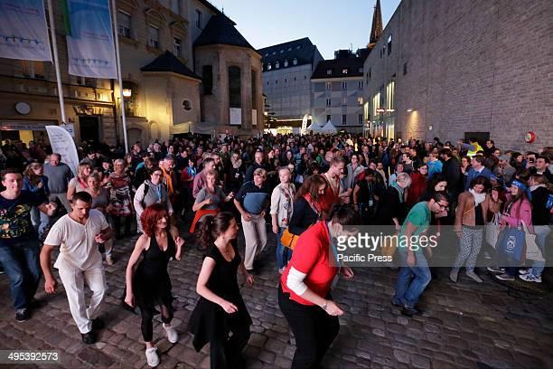 REGENSBURG BAVARIA GERMANY Visitors to the 99th Deutscher Katholikentag dance to Latin rhythms on the last evening Over 80000 visitors have visited...
