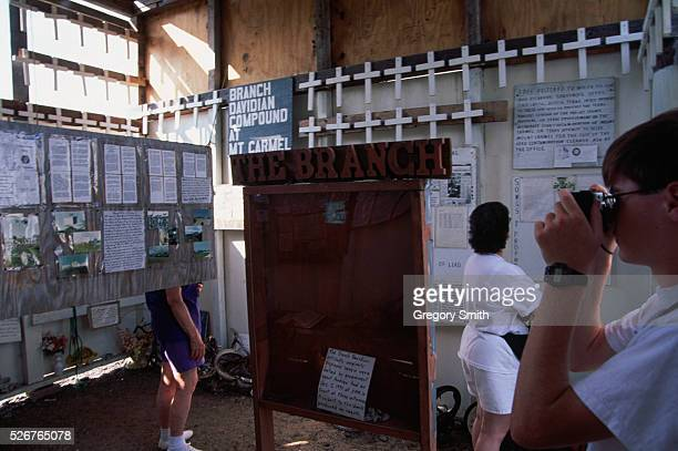 Visitors to the Branch Davidian's Mount Carmel compound near Waco Texas look at an exhibit on the deadly 1993 standoff In February of 1993 the Branch...