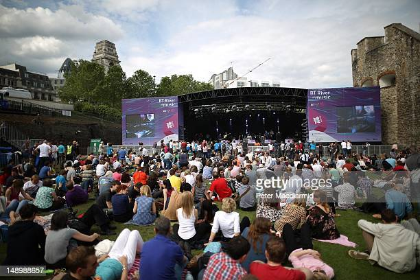Visitors to the BT River of Music Festival watch a band on the Americas Stage at The Tower of London on July 21, 2012 in London, England. As part of...