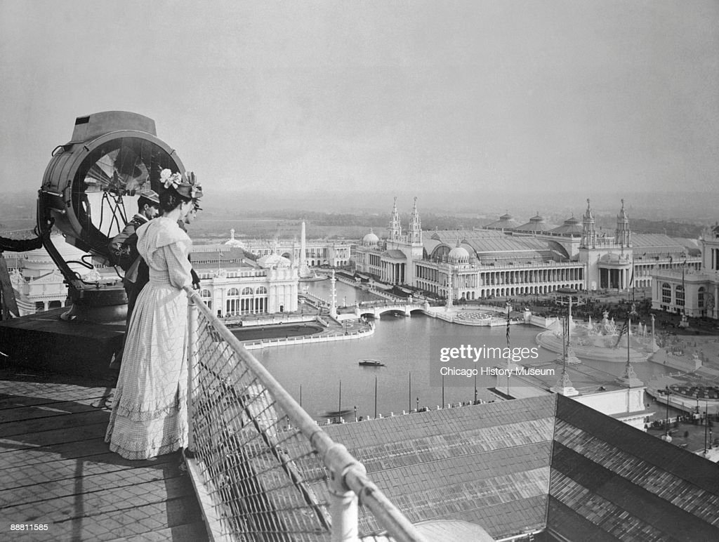 Visitors to the Chicago World's Columbian Exposition looks out over the Basin and The Court of Honor, Chicago, IL, 1893. This view of the Court of Honor, the architectural showpiece of the fair, looks from southeast to northwest over the Grand Basin. It is taken from atop the Manufacturers and Liberal Arts Building which housed manufactured wares from companies all over the world � everything from ceramics to jewelry.