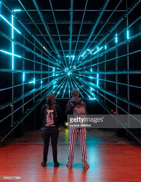 Visitors to the congress stand in front of a 3D tunnel at the Chaos Communication Congress in Hamburg,Germany, 27 December 2016. The world's largest...