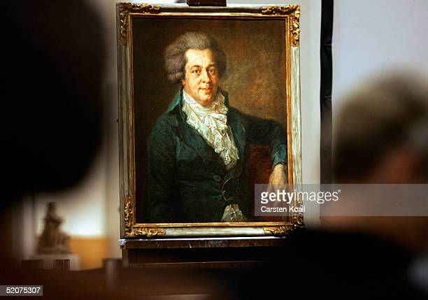 Visitors to The Gemaeldegalerie art gallery looks at the recently discovered Wolfgang Amadeus Mozart portrait by the artist Johann Georg Edlinger at...