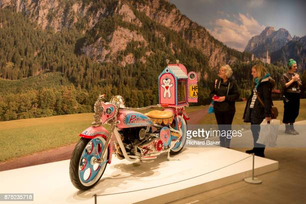 Visitors to the Grayson Parry exhibition entitled 'The Most Popular Art Exhibition Ever' admire his pink motorbike teddy bear pilgrimage on 5th...
