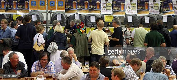 Visitors to the Great British Beer Festival enjoy their pints on August 5, 2008 in London, England. The annual Great British Beer Festival runs from...