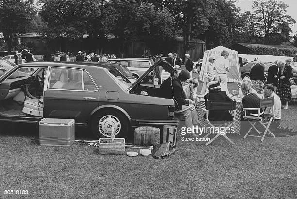 Visitors to the Henley regatta at HenleyonThames set up their picnic from the back of their Bentley motor car 2nd July 1997