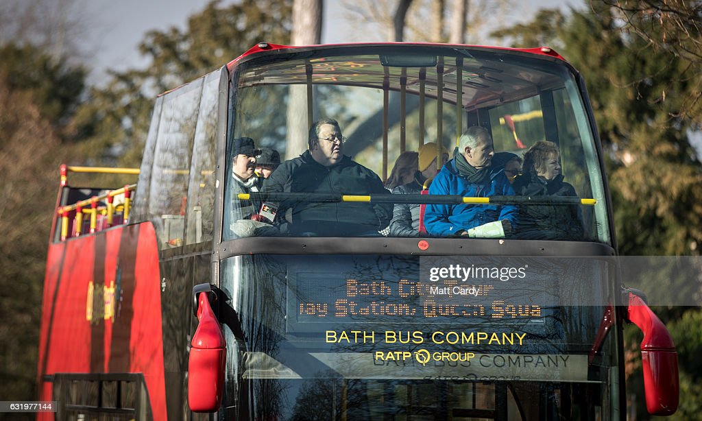 Visitors to the historic city of Bath pass the Royal Crescent in a tour bus on January 18, 2017 in Bath, England. Plans for a possible overnight tourist bed tax are currently being discussed by Bath and North East Somerset council as one possible way of helping to bridge the £37million of cuts currently required by 2020. The city, a UNESCO World Heritage site, is famed for its Roman remains and Georgian architecture and attracts visitors from across the world.